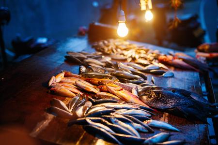 Fresh fish at night seafood market Stock Photo