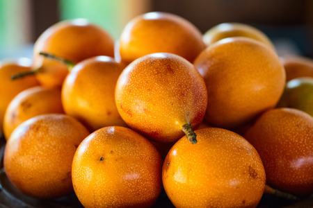 Selection of fresh passion fruits at market for sale Archivio Fotografico