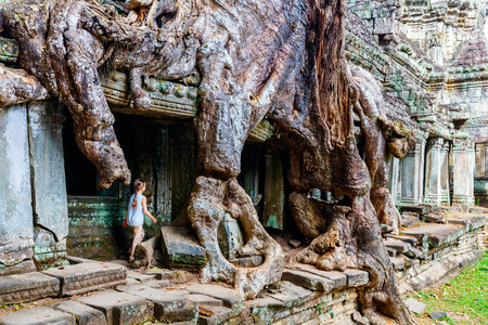 Little girl at ancient Preah Khan temple in Angkor Archaeological area in Cambodia Stock Photo