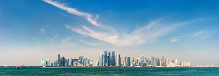 Panoramic view of Doha Qatar skyline on sunny day