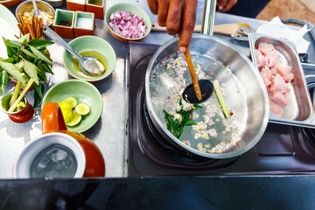Preparation of traditional Sri Lankan curry dish at cooking class