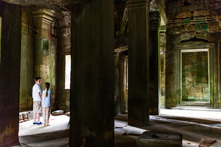 Kids at ancient Angkor Wat temple in Siem Reap in Cambodia