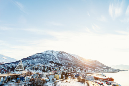 Beautiful winter landscape of snow covered town Tromso in Northern Norway Stock Photo - 97961844