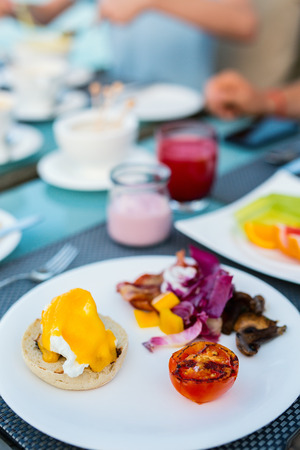 Delicious breakfast with eggs Benedict, vegetables and youghurt Reklamní fotografie