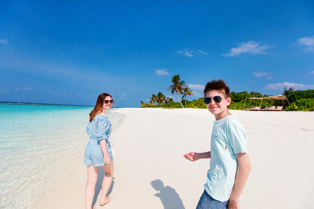 Family mother and son enjoying tropical beach vacation