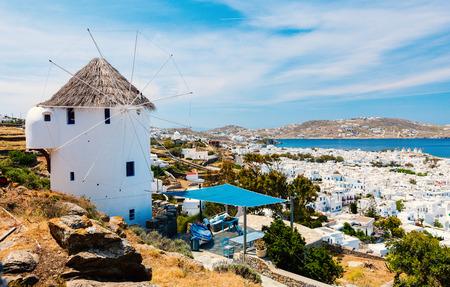 White greek windmill overlooking traditional village on Mykonos Island, Greece, Europe
