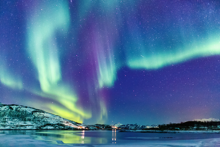 Incredible Northern lights Aurora Borealis activity above the coast in Norway