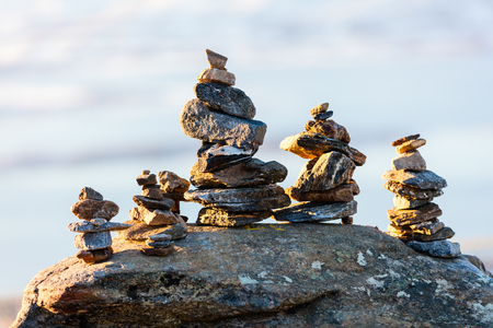 Stack of balanced stones on seashore