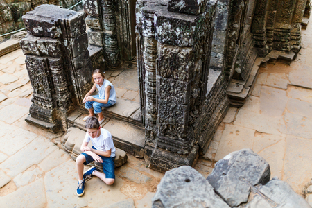 Kids at ancient Angkor temple complex in Siem Reap in Cambodia