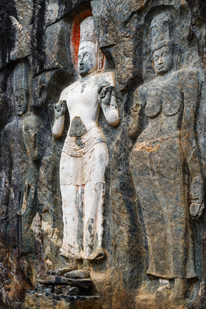 Buduruwagala temple with well preserved carvings on the wall in Wellawaya Sri Lanka