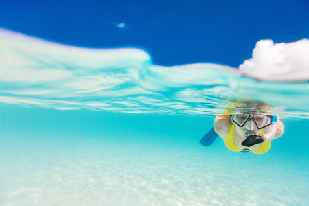 Split photo of young woman snorkeling in tropical ocean