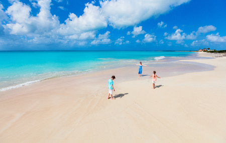 Family mother and kids enjoying tropical beach vacation 写真素材
