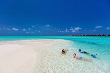 Above view of mother and kids enjoying tropical beach vacation Stock Photo