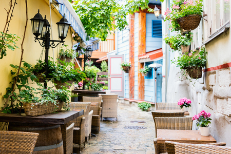 Street with outdoor restaurant tables in Tallinn old town, Estonia, Europe 写真素材