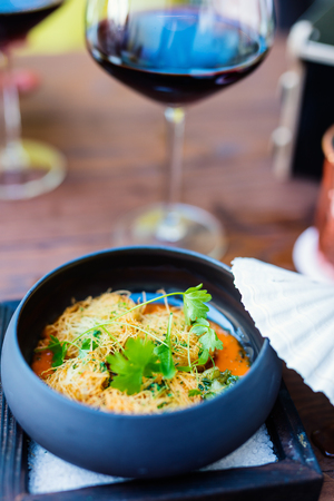 Delicious lunch or dinner served with red wine in a restaurant