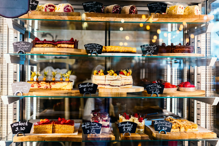 Pastry shop glass display with selection of sweets and cakes