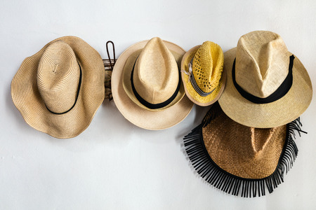 Straw hats on a rack