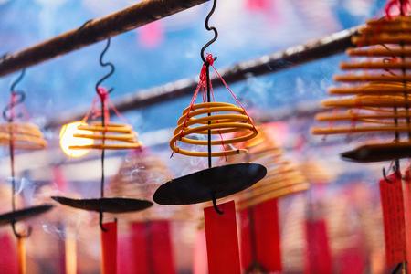 Circular incenses burning in Man Mo Temple, Hong Kong, China Stock Photo