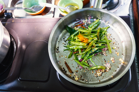Preparation of traditional Sri Lankan dish with green beans at cooking class Stock Photo