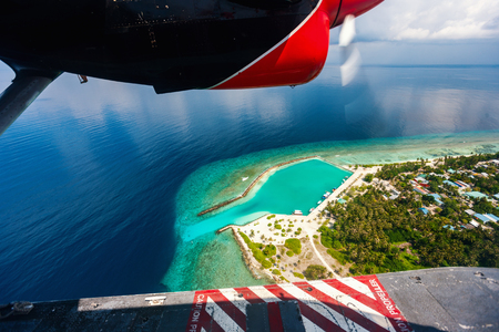 Aerial view of Maldives tropical island seen from a sea plane Stok Fotoğraf