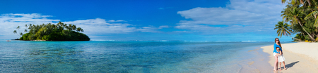 Panorama of mother and daughter at tropical beach on exotic island