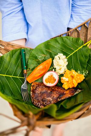 Close up of some local south pacific origin food on a weaved platter Stock Photo