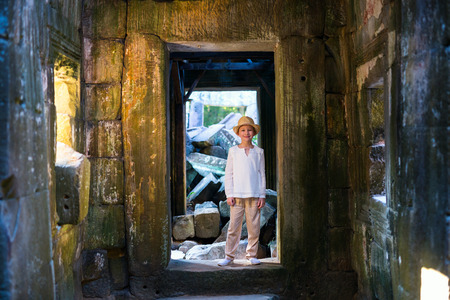 Little girl in ancient temple in Siem Reap, Cambodia