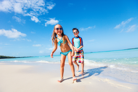 Brother and sister enjoying time at tropical beach Stock Photo