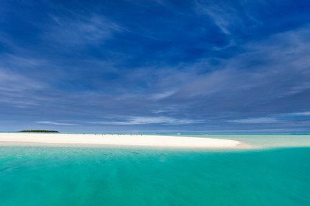 Stunning tropical lagoon and exotic islands with palm trees, white sand, turquoise ocean water and blue sky at Cook Islands, South Pacific