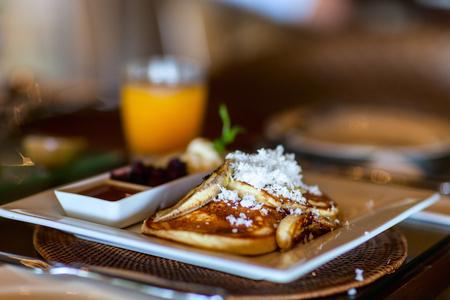 Delicious banana pancakes served for breakfast Standard-Bild - 102214088