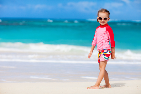 Portrait of cute little girl at tropical beach 写真素材 - 102214111