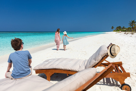 Family mother and kids enjoying tropical beach vacation in luxury resort Stock Photo