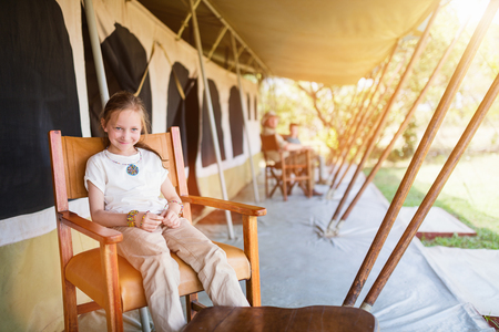 Family in safari tent enjoying vacation in Africa