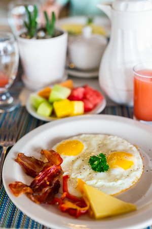 Delicious breakfast with fried eggs and bacon