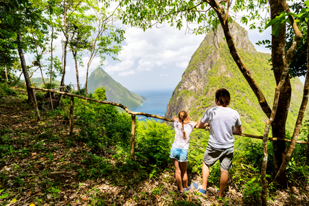 Back view family of father and daughter enjoying scenery of Piton mountains on St Lucia island in Caribbean