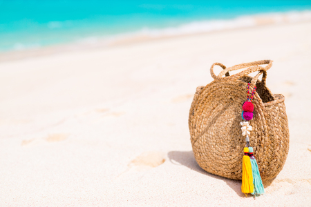 Straw bag close up on tropical beach vacation