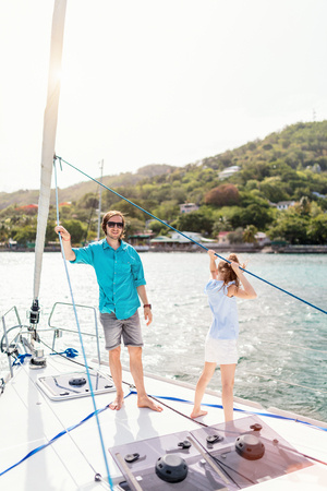 Father and daughter on board of sailing yacht having summer travel adventure
