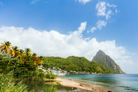 Idyllic white sand tropical beach with view to Piton mountains in Saint Lucia Caribbean Stock Photo