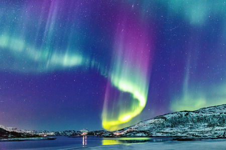 Incredible Northern lights Aurora Borealis activity above the coast in Norway Zdjęcie Seryjne - 107393984