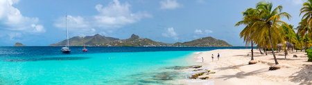 Panorama of mother and kids enjoying tropical beach vacation on exotic island in St Vincent and the Grenadines