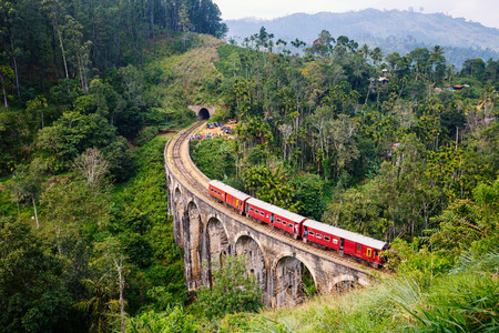 Spectacular view of a train crossing over Nine Arches bridge in Demodara one of the iconic landmarks in Sri Lanka