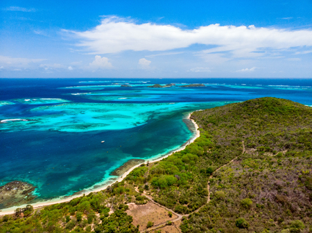 Aerial drone view of tropical island of Mayreau and turquoise Caribbean sea in St Vincent and Grenadines