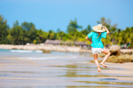 Adorable little girl having fun at Ngapali beach in Myanmar during summer vacation Stok Fotoğraf