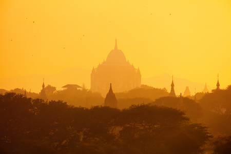 Scenic sunset with thousands of historic buddhist temples and stupas in Bagan Archeological area in Myanmar