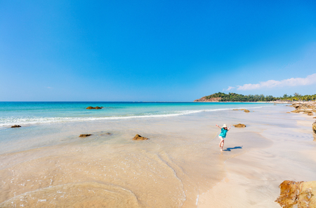 Adorable little girl at Ngapali beach in Myanmar during summer vacation