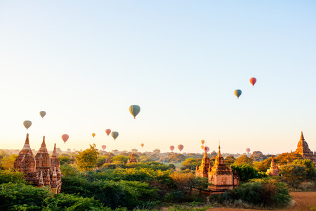 Stunning landscape view of hot air balloons fly over thousands of ancient pagodas at morning in Bagan Myanmar Stock fotó