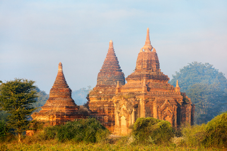Stunning landscape view of historic buddhist pagodas in Bagan Archeological area in Myanmar Banco de Imagens