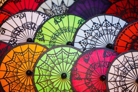 Colorful traditional parasols handmade in factory in Myanmar 写真素材 - 117618457