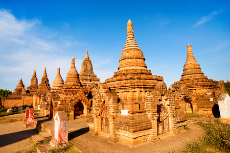Stunning view of historic buddhist pagodas in Bagan Archeological area in Myanmar 스톡 콘텐츠 - 117618459