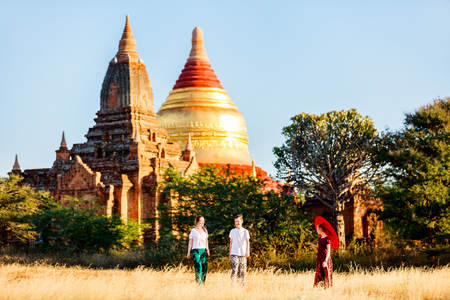 Family of mother and kids visiting Dhammayazika Pagoda and ancient temples in Bagan Archeological area in Myanmar